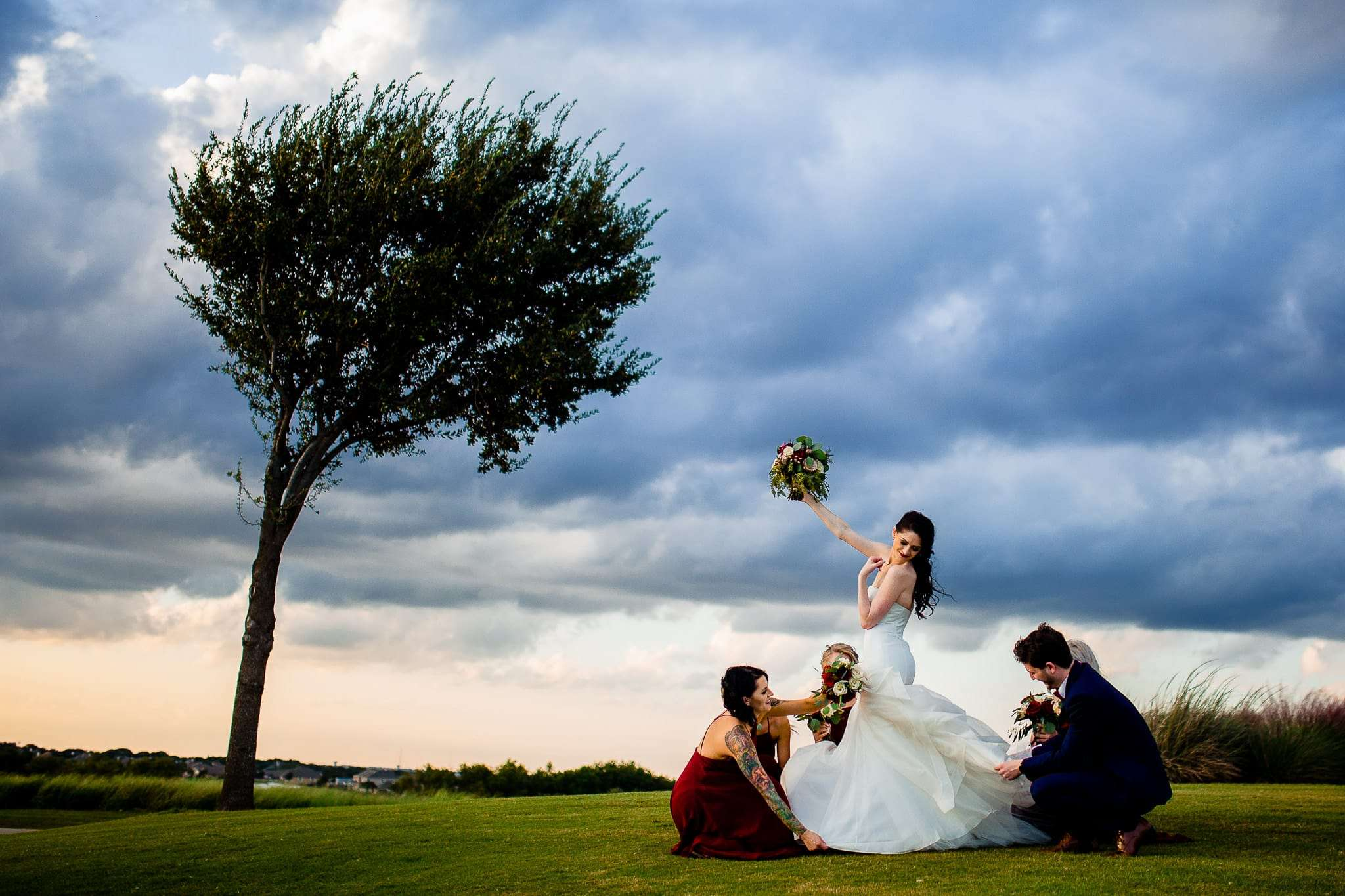 austin wedding photographer bridal party with friends dramatic sky
