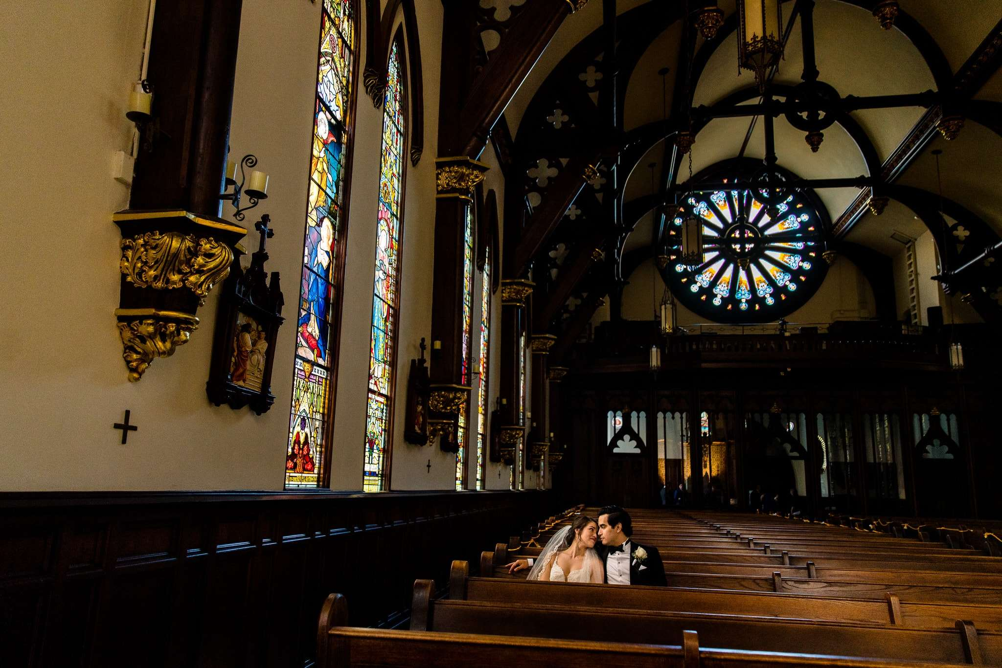austin wedding photographers couple sits in st. mary's cathedral in downtown austin after getting married